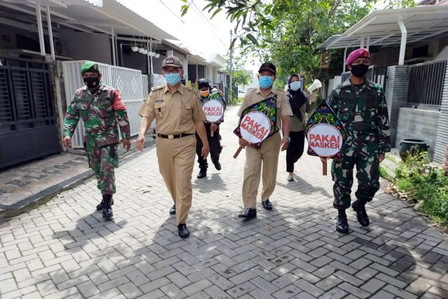 Satgas PPKM Mikro Menart 2 Marinir Pasmar 2 Laksanakan PAM Prokes